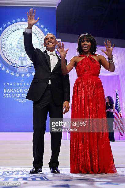 S President Barack Obama and first lady Michelle Obama wave goodbye after attending the ComanderinChief's Inaugural Ball at the Walter Washington...