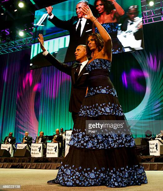 S President Barack Obama and first lady Michelle Obama wave on stage after President Obama delivered remarks at the Congressional Black Caucus...