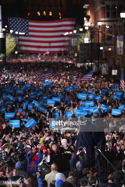 S President Barack Obama and first lady Michelle Obama wave to supporters during his last rally the night before the general election November 5 2012...