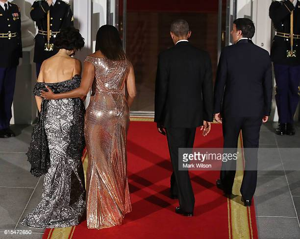 S President Barack Obama and first lady Michelle Obama welcome Italian Prime Minister Matteo Renzi and his wife Mrs Agnese Landini upon arrival for a...