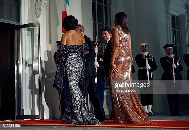 US President Barack Obama and First Lady Michelle Obama welcome Italian Prime Minister Matteo Renzi and his wife Agnese Landini on the North Portico...