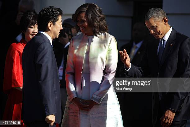 US President Barack Obama and first lady Michelle Obama welcome Japanese Prime Minister Shinzo Abe and his wife Akie Abe during an official arrival...