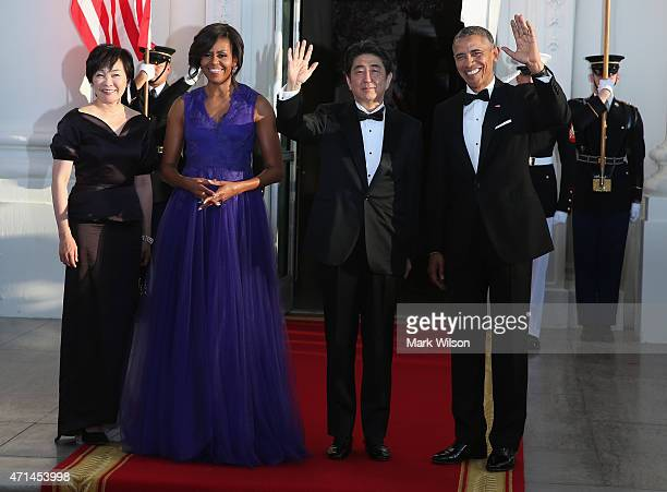 S President Barack Obama and first lady Michelle Obama welcome Japanese Prime Minister Shinzo Abe and his wife Akie Abe after they arrived at the...