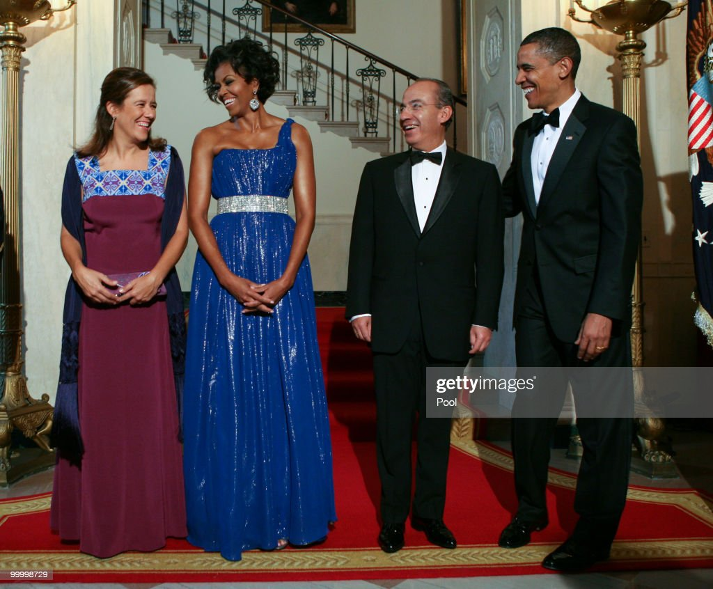 U.S. President Barack Obama and first lady Michelle Obama welcome Mexican President Felipe Calderon and his wife Margarita Zavala to the White House for a state dinner May 19, 2010 in Washington, DC. Earlier in the day, Calderon, in a rare rebuke for a foreign leader on U.S. soil, assailed Arizona's tough new immigration law as 'discriminatory,' a sentiment echoed by Obama during a joint Rose Garden news conference.