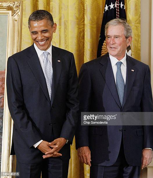 S President Barack Obama and former US President George W Bush stand together during the unveiling ceremony for Bush's offical portrait at the White...