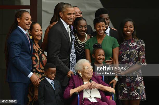 President Barack Obama and four generations of the Bonner family who are descendants of slaves stand together to have their picture taken after...
