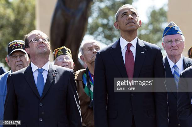 US President Barack Obama and French President Francois Hollande watch a missing man formation flyover during the 70th FrenchAmerican Commemoration...