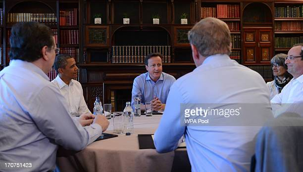 S President Barack Obama and French President Francoise Hollande glance at Britain's Prime Minister David Cameron during an EU/US trade meeting at...
