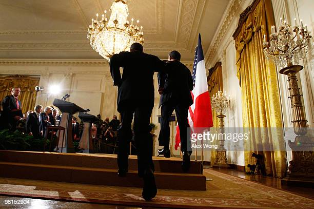 S President Barack Obama and French President Nicolas Sarkozy run onto the stage for a joint press conference in the East Room of the White House...