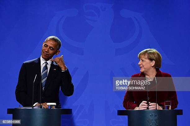 US President Barack Obama and German Chancellor Angela Merkel address a press conference after their meeting at the chancellery in Berlin on November...