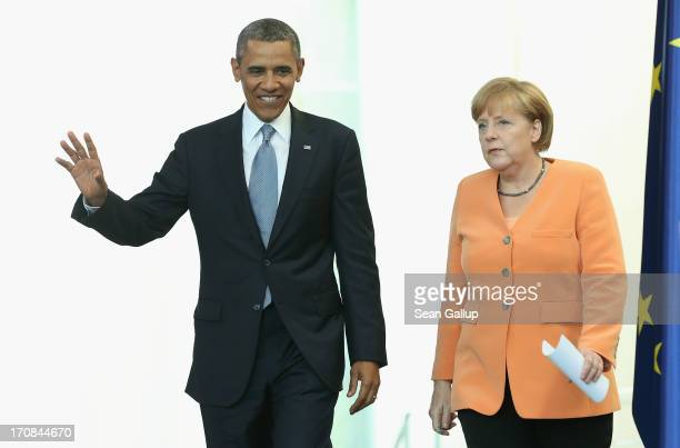 S President Barack Obama and German Chancellor Angela Merkel arrive to speak to the media following bilateral talks at the Chancellery on June 19...