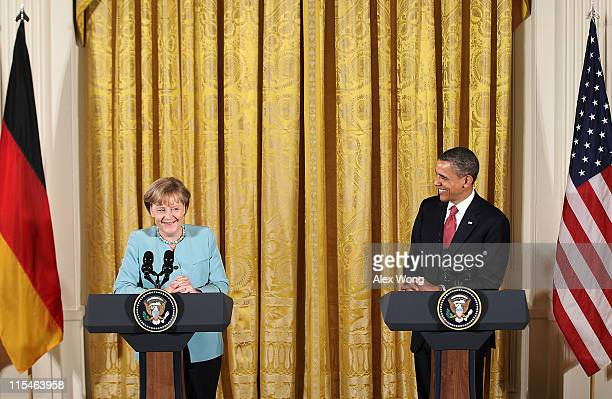 S President Barack Obama and German Chancellor Angela Merkel participate in a joint press conference after a meeting in the Oval Office of the White...