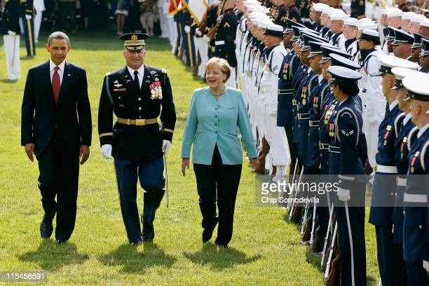 S President Barack Obama and German Chancellor Angela Merkel review the troops during a welcome ceremony to the White House on the South Lawn June 7...