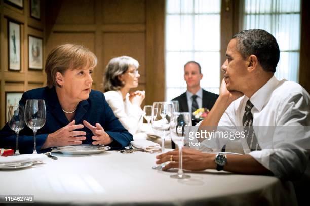 S President Barack Obama and German Chancellor Angela Merkel speak druing a private dinner at '1789' restaurant on June 7 2011 in Washington DC...