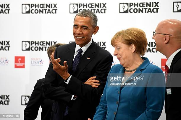 S President Barack Obama and German Chancellor Angela Merkel visit the Phoenix Contact stand at the Hannover Messe industrial trade fair on April 25...