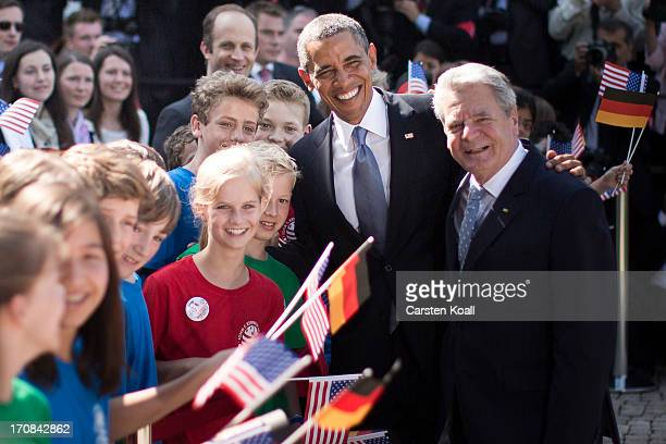 President Barack Obama and German President Joachim Gauck greet schoolchildren from a local German-American school at Bellevue Palace on June 19,...