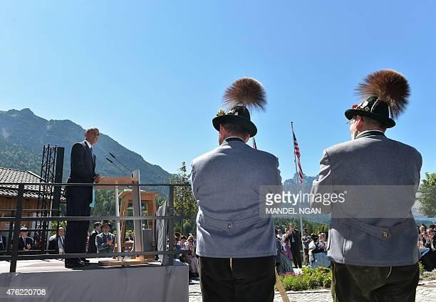 President Barack Obama and Germany's Chancellor Angela Merkel deliver their speech in the village of Kruen near Garmisch-Partenkirchen on June 7,...