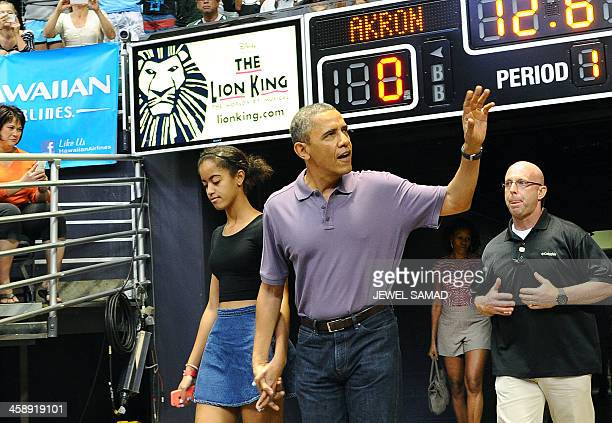 US President Barack Obama and his daughter Malia arrive to watch the Oregon State University vs University of Akron college basketball game at the...