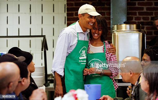 President Barack Obama and his daughter Malia honor the Martin Luther King legacy by serving meals to the needy at a facility January 18, 2010 in...