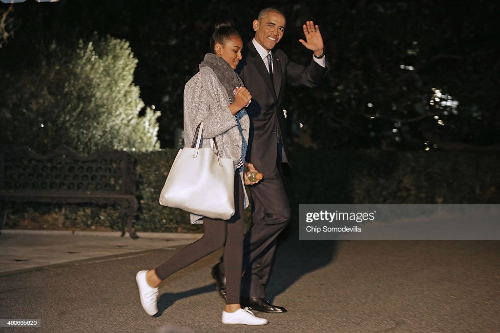 U.S. President Barack Obama and his daughter Sasha Obama leave the White House for their holiday vacation December 19, 2014 in Washington, DC. The first family will spend Christmas and the New Year in Hawaii.