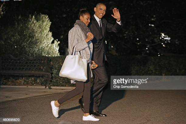 S President Barack Obama and his daughter Sasha Obama leave the White House for their holiday vacation December 19 2014 in Washington DC The first...