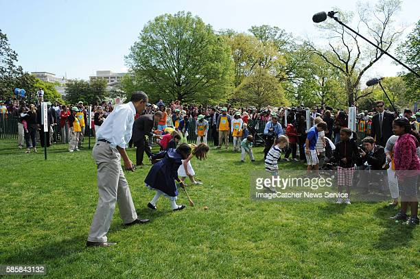 President Barack Obama and his family host the annual White House Easter Egg Roll The President coaches some of the egg rollers