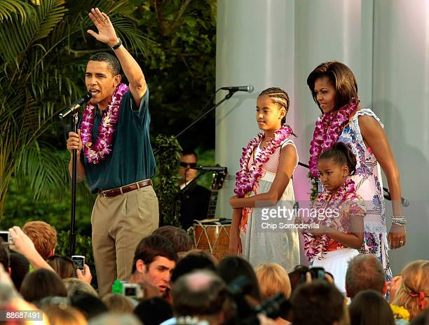 President Barack Obama and his family Malia Obama Michelle Obama and Sasha Obama host a luau for members of Congress and their families on the South...