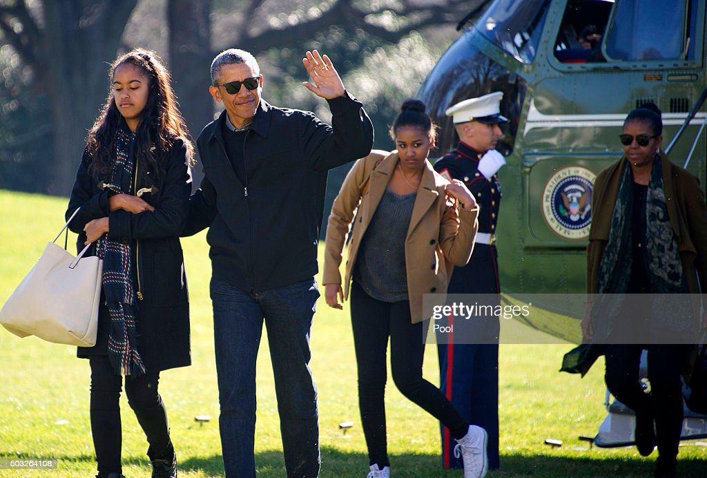 Obamas Return From Hawaii Vacation