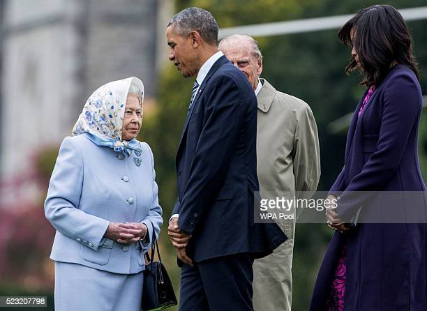 President Barack Obama and his wife First Lady Michelle Obama are greeted by Queen Elizabeth II and Prince Phillip Duke of Edinburgh after landing by...