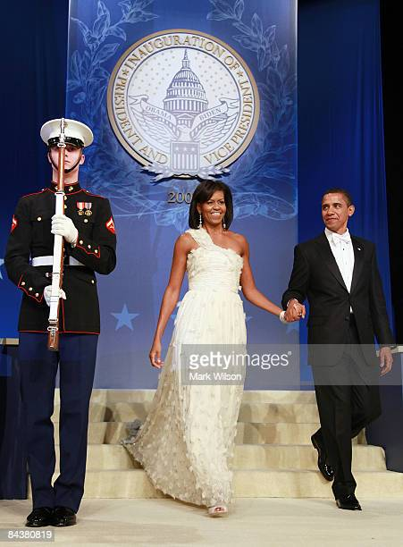President Barack Obama and his wife Michelle arrive at the Obama Homes States Ball one of ten official inaugural balls January 20 2009 in Washington...