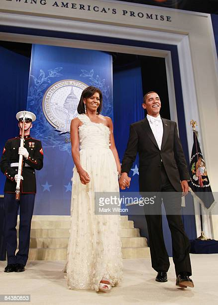 President Barack Obama and his wife Michelle arrive at the Obama Homes States Ball, one of ten official inaugural balls January 20, 2009 in...