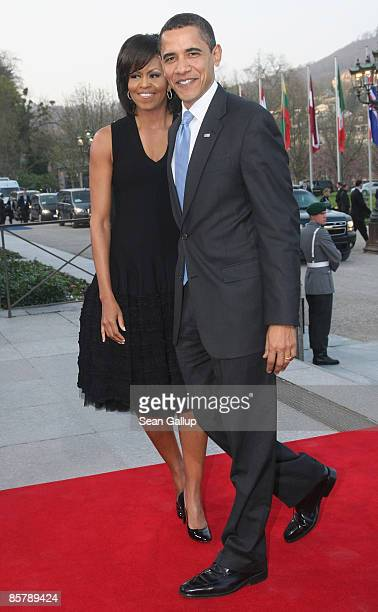 S President Barack Obama and his wife Michelle arrive at the opening of the NATO summit at the Kurhaus on April 3 2009 in Baden Baden Germany Heads...