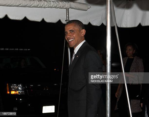 President Barack Obama and his wife Michelle arrive at the White House in Washington on November 7, 2012 upon his return from Chicago, one day after...