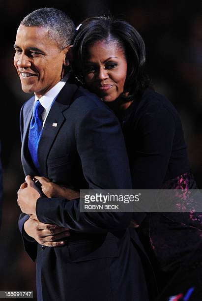 US President Barack Obama and his wife Michelle celebrate on stage after Obama delivered his acceptance speech on November 7 2012 in Chicago Obama...