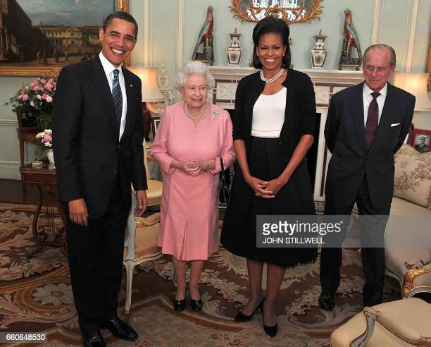 US President Barack Obama and his wife Michelle meet with Britain's Queen Elizabeth II and Prince Philip the Duke of Edinburgh during an audience at...