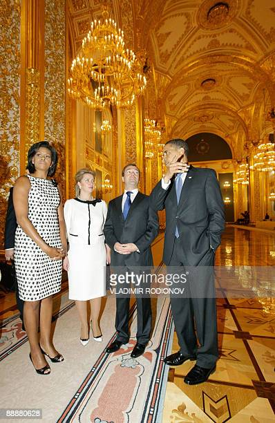 US President Barack Obama and his wife Michelle meet with Russian President Dmitry Medvedev and his wife Svetlana at the Kremlin in Moscow on July 7...