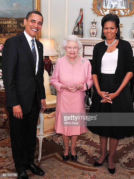 President Barack Obama and his wife Michelle Obama pose for photographs with Queen Elizabeth II during an audience at Buckingham Palace on April 1...