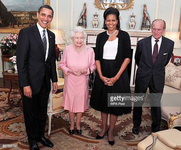 President Barack Obama and his wife Michelle Obama pose for photographs with Queen Elizabeth II and Prince Philip, Duke of Edinburgh during an...