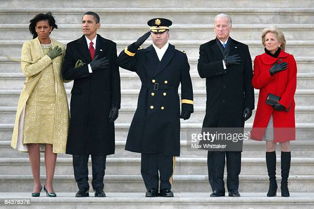 President Barack Obama and his wife Michelle stand at attention on the stairs of the US Capitol with VicePresident Joe Biden and his wife Jill Biden...