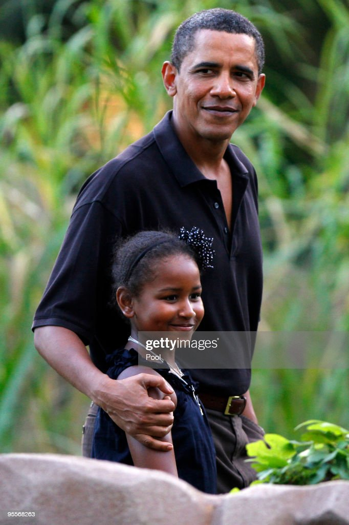 U.S. President Barack Obama and his youngest daughter Sasha, 8, walk through the Honolulu Zoo on Sunday, January 3, 2009 in Honolulu, Hawaii. Obama and his family are spending the holidays in his native Hawaii.