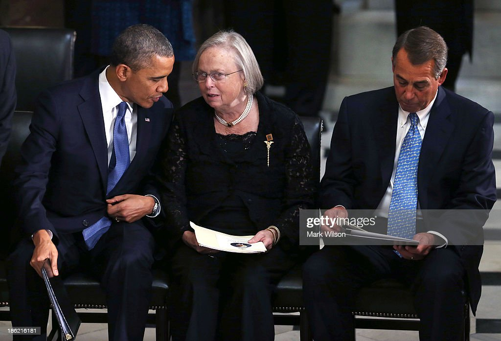 U.S. President Barack Obama (L) and House Speaker John Boehner (R-OH) sit with Heather Foley during a memorial service for for her husband former House Speaker Tom Foley (D-WA) at the U.S. Capitol, October 29, 2013 in Washington, DC. President Obama and members of Congress gathered for a Congressional Memorial Service celebrating the life of former House Speaker Tom Foley (D-WA) who died on October 18.