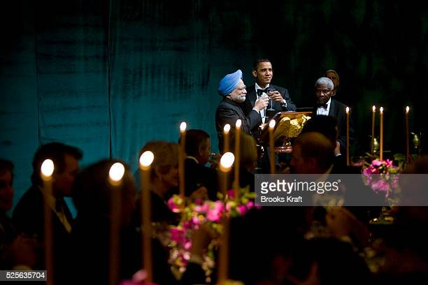 President Barack Obama and Indian Prime Minister Manmohan Singh toast each other during the first official State Dinner of Obama's administration at...
