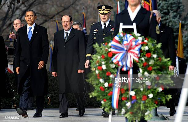 US President Barack Obama and Iraqi Prime Minister Nouri alMaliki participate in a wreath laying ceremony at Arlington National Cemetery December 12...