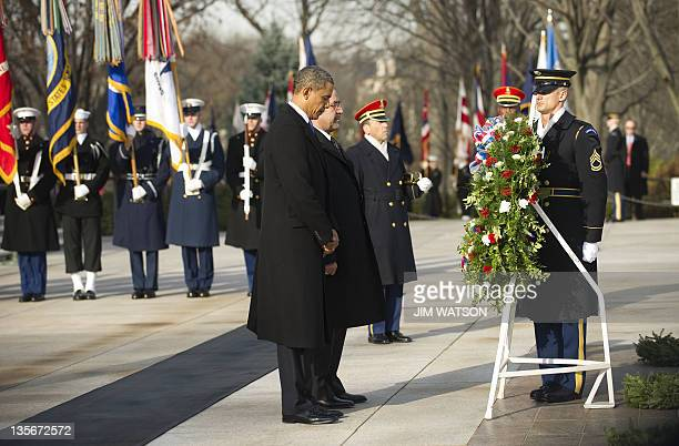 US President Barack Obama and Iraqi Prime Minister Nouri alMaliki lay a wreath at the Tomb of the unknown Soldier at Arlington National Cemetery in...