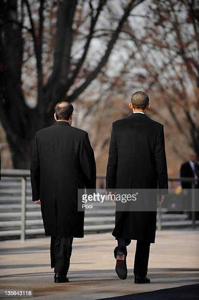 US President Barack Obama and Iraqi Prime Minister Nouri alMaliki leave after participating in a wreath laying ceremony at Arlington National...