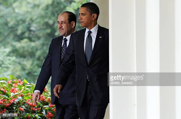 US President Barack Obama and Iraqi Prime Minister Nuri alMaliki arrive to give a joint press conference following their meeting at the Rose Garden...