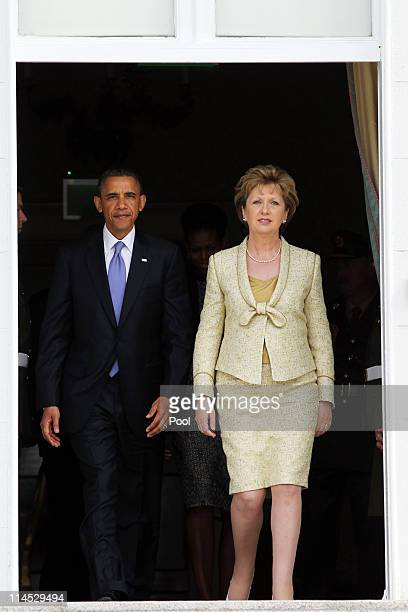 President Barack Obama and Irish President Mary McAleese walk out of Aras an Uachtarain, the official residence of the President of Ireland, May 23,...