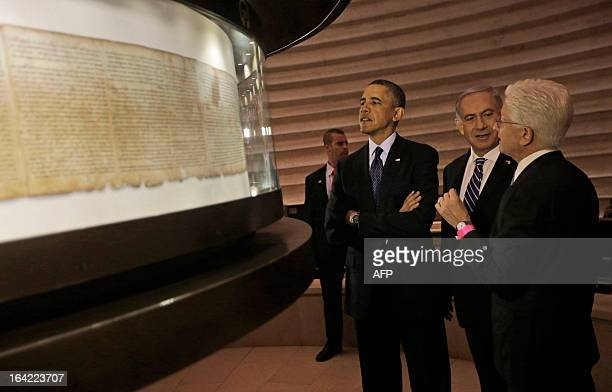 US President Barack Obama and Israeli Prime Minister Benjamin Netanyahu view the Dead Sea Scroll during a visit to the Israel Museum in Jerusalem on...