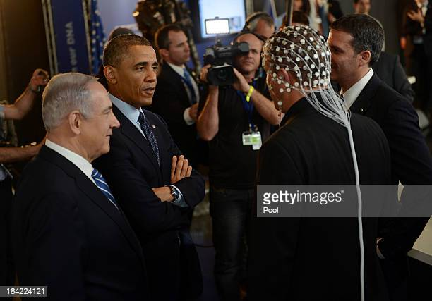 S President Barack Obama and Israeli Prime Minister Benjamin Netanyahu talk to a man wearing a net to check brain activity at an Israeli technology...