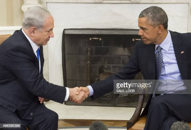 President Barack Obama and Israeli Prime Minister Benjamin Netanyahu shake hands during a meeting in the Oval Office of the White House in...